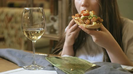 cutlery : Beautiful blonde woman eating and drinking in restaurant, lunch break Stock Footage