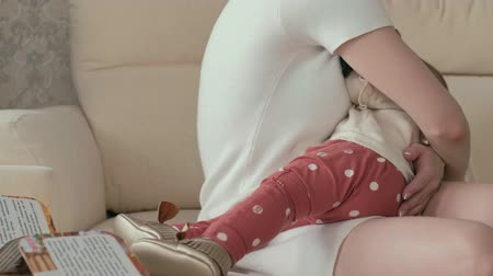 падение : Mom with a baby girl in her arms. maternity concept