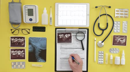 magnifier : Top view of the therapists desktop, ECG results on a computer tablet, ultrasound, medicine and health care concept Stock Footage