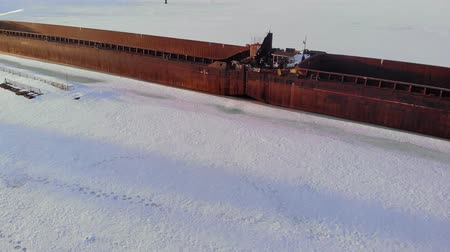 que vale a pena : old ship, barge, on a frozen river, aerial shooting