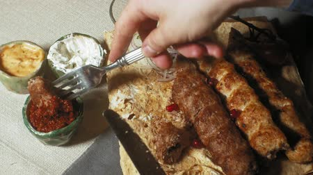 cuisine dark : close-up shooting: grilled meat, kebab with vegetables and various sauces. Stock Footage