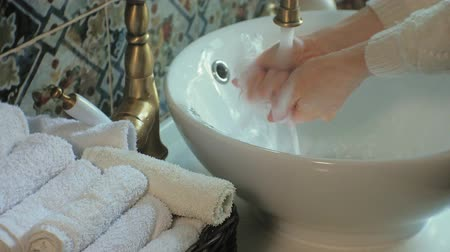 towel folded : Woman washes her hands and dries them, concept of cleanliness Stock Footage