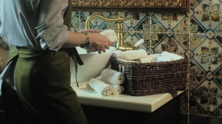 сложены : Woman folds clean soft towels in the basket, cleaning concept Стоковые видеозаписи