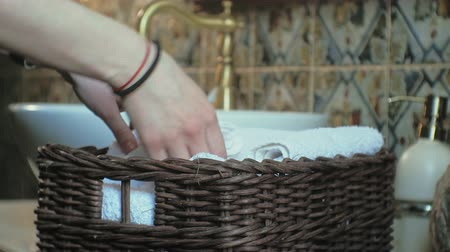 towel folded : Woman folds clean soft towels in the basket, cleaning concept Stock Footage