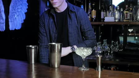 martini glasses : making an alcoholic cocktail at the bar Stock Footage