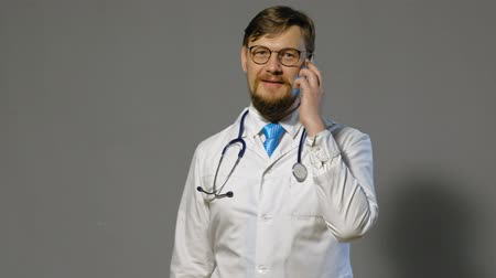 his : doctor man in white coat on gray background, medicine concept