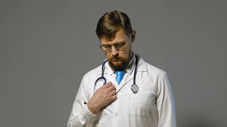 baptized : doctor man in white coat on gray background, medicine concept