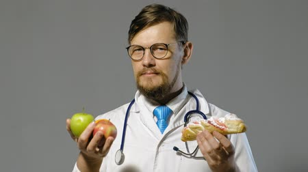 harmful : doctor man in white coat on gray background, medicine concept
