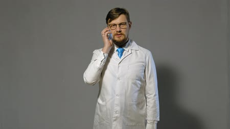 medics : doctor man in white coat on gray background, medicine concept