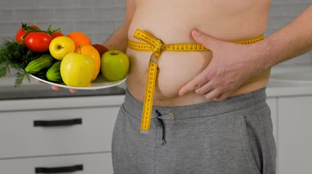 torzó : fat man measuring his waist, healthy eating, healthy lifestyle concept, fitness diet