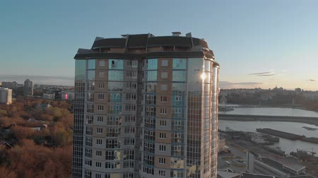 bank tower : Cityscape. Residential complex on the river bank. Aerial footage from a copter at sunset time