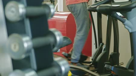 elliptical : man with elliptical machine in the gym. Stock Footage