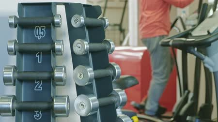 pound : Stand with dumbbells in the gym Stock Footage