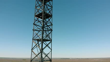 outlook : metal tower in the field, aerial shooting