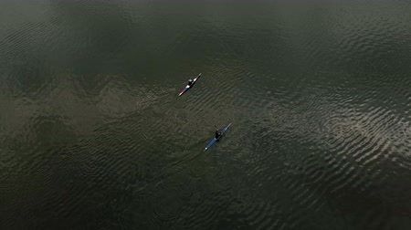 kenu : Athletes on the blue canoes on the river. Healthy lifestyle. Active sport. Air filming with drone. Stock mozgókép