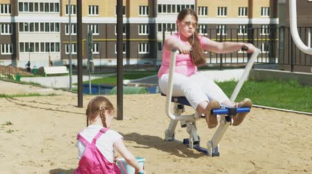 teen age : Teenager girl on the open site with exercise equipment. healthy lifestyle Stock Footage