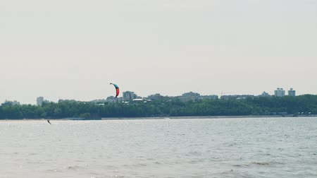 kite boarding : People on the river in the summer engaged in kitesurfing. Extreme sport Stock Footage