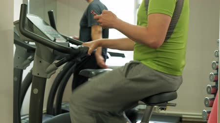 rögzített : man on exercise bike in the gym. Healthy lifestyle concept