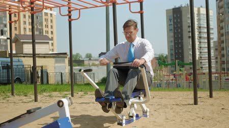 cardio : Businessman on an outdoor sports field. The concept of a healthy lifestyle.