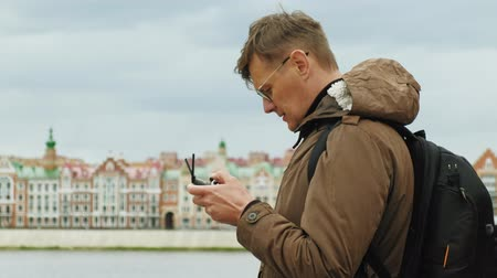 bruges : Man controls the drone outdoors.