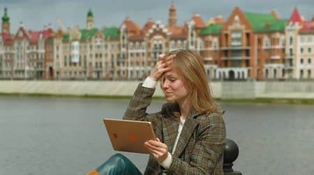 bruges : woman uses tablet outdoors. Spring