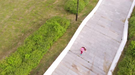 階段 : Teen girl runs up the stairs. Sport. Aerial shooting
