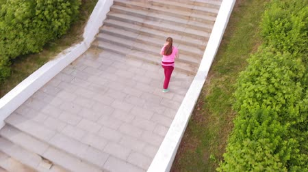 run down : Teen girl runs up the stairs. Sport. Aerial shooting
