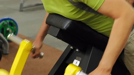 pumping : Man works out at the gym on simulators. Sport .Healthy lifestyle Stock Footage