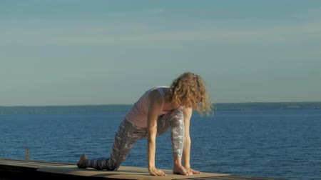 cobra : Young woman practicing yoga outdoors in summer. Healthy lifestyle