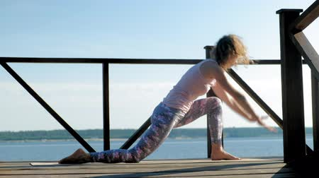 eight : Young woman practicing yoga outdoors in summer. Healthy lifestyle