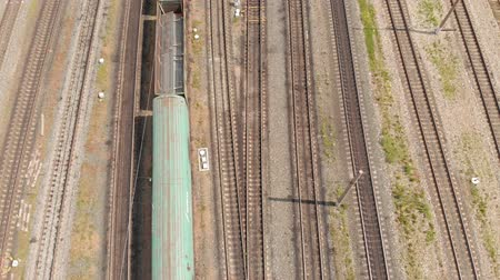 tren de carga : Railway tracks with freight trains top view. aerial survey Archivo de Video