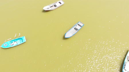 Boats on the background of the yellow sea. Aerial shot Vídeos