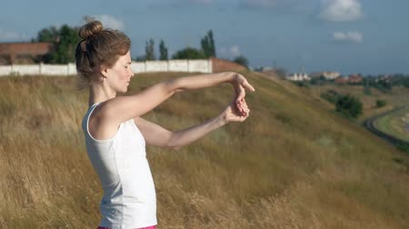 engaged : Young woman doing sports outdoors, yoga Stock Footage