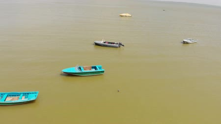 Boats on the background of the yellow sea. Aerial shot Stock mozgókép