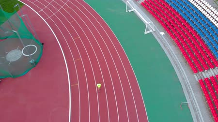 トラック : A man runs on a treadmill at the stadium. Summer time