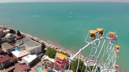 kerekek : Ferris wheel on the seashore. Aerial shot
