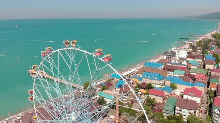 наблюдения : Ferris wheel on the seashore. Aerial shot