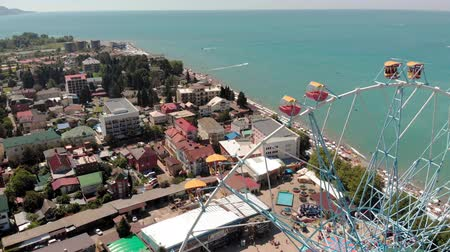 Ferris wheel on the seashore. Aerial shot