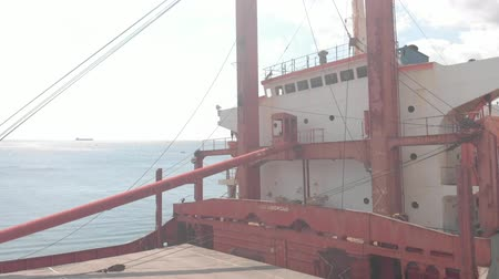 stationary : Cargo Ship aground at sea.
