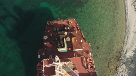 kotva : Cargo Ship aground at sea.