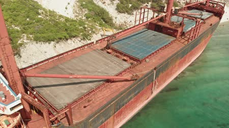 after the storm : Cargo Ship aground at sea.