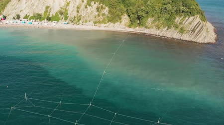 rocky mountains : Beautiful bay in the blue sea. Aerial shot Stock Footage