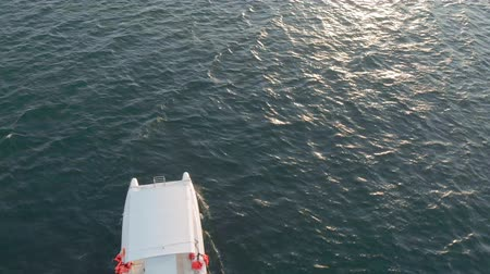 follow shot : Flight over a pleasure boat at sea. Aerial shot Stock Footage