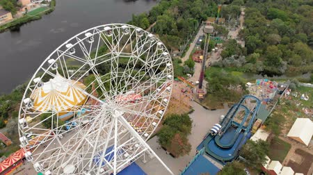 aqua park : Amusement park by the sea. View of the ferris wheel and the water park with a drone. Shooting from a height