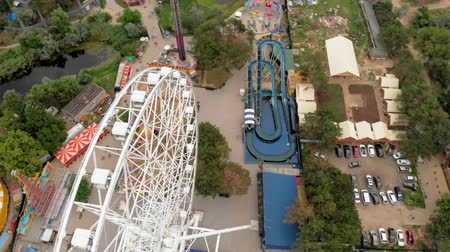 рост : Amusement park by the sea. View of the ferris wheel and the water park with a drone. Shooting from a height