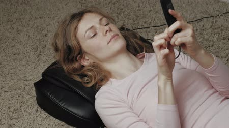 massager : A woman uses a massager Stock Footage