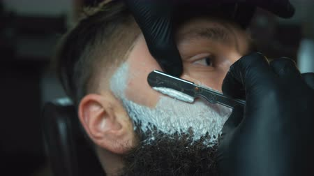 barbear : Barber cutting bearded brutal man, barber shop salon