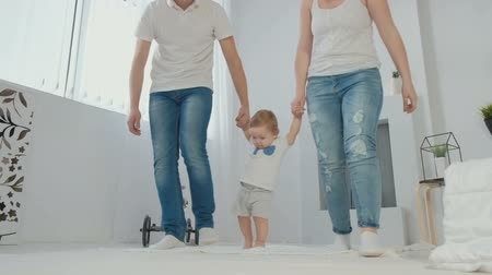 denemek : Cute little boy takes the first steps, goes to the white sunny living room Stok Video
