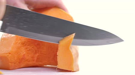 pumpkin pieces : Sliced pumpkin and knife on a white background