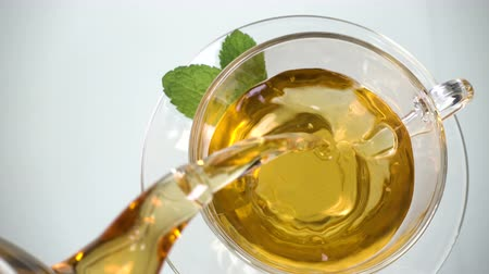 brew tea : Glass cups of tea with mint on isolated on white background. top view Stock Footage